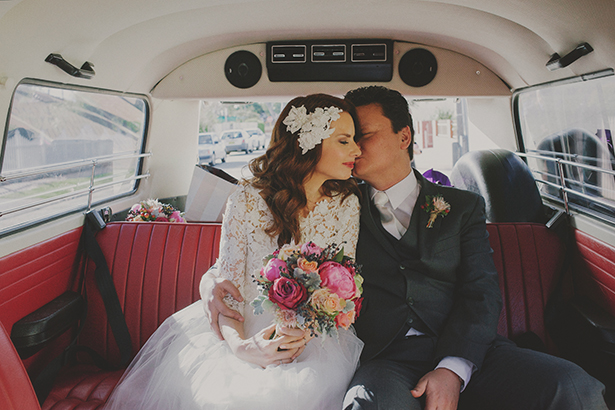 Bride and Groom in Retro Car